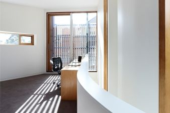 The use of slats means privacy and interesting light patterns in the first floor study