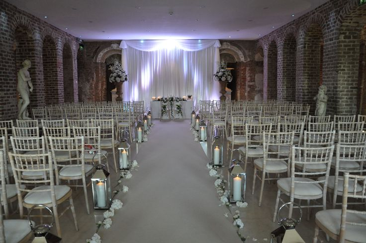 Civil Ceremony with white chiavari chairs in Powerscourt House. Visit www.gotchacovered.ie