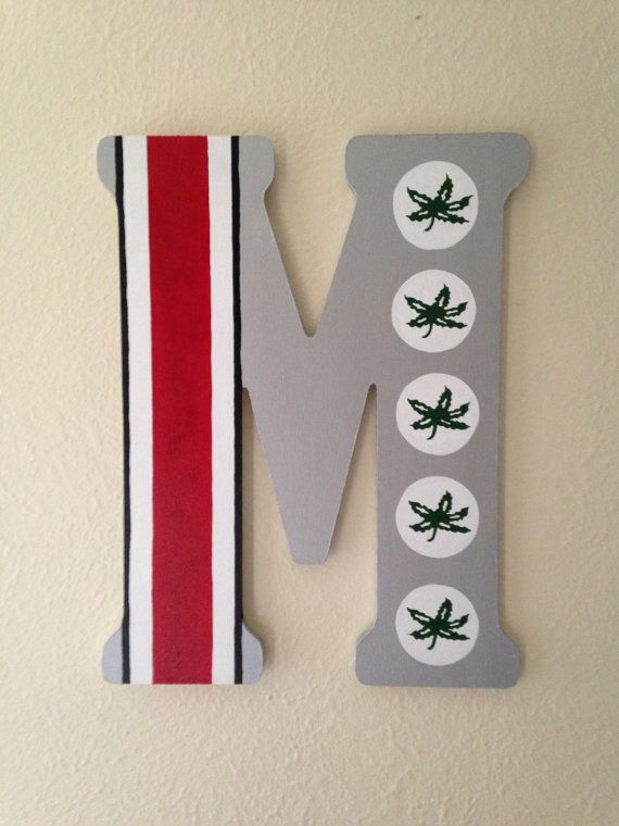 O-H-I-O! Buckeye Nation unite!    Show some buckeye pride while displaying this oversized wooden letter of your choice. This custom work of art