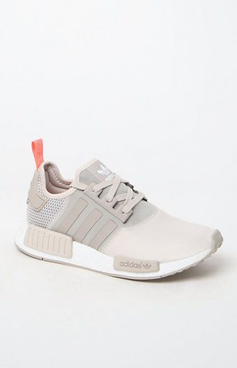 adidas combines modern streetwear style with innovative technology in the Women's NMD_R1 Brown Low-Top Sneakers. Fashioned in a brown hue, these low-top sneakers feature a soft suede and peached jersey upper, durable and shock-resistant angled boost™ midsole with built-in EVA plugs, and bold archival details.   boost™'s energy-returning properties keep every step charged with an endless supply of light, fast energy Premium suede and peached jersey upper Overlock deco stitching...