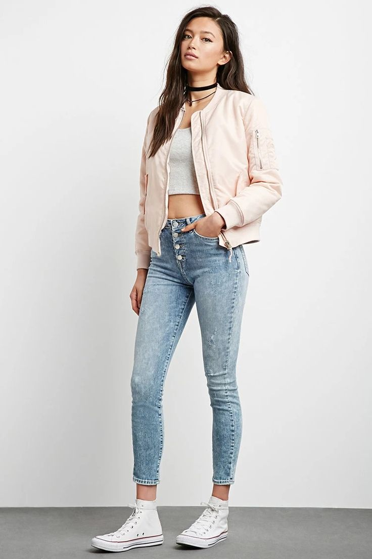 A pair of denim woven skinny jeans with a high-waisted fit, exposed button fly, and a five-pocket construction. #f21denim