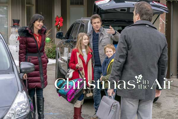 Christmas in the Air Movie follows Robert and Lydia as they bond over holidays when Lydia comes to organize his life. #Hallmark #movies #romance