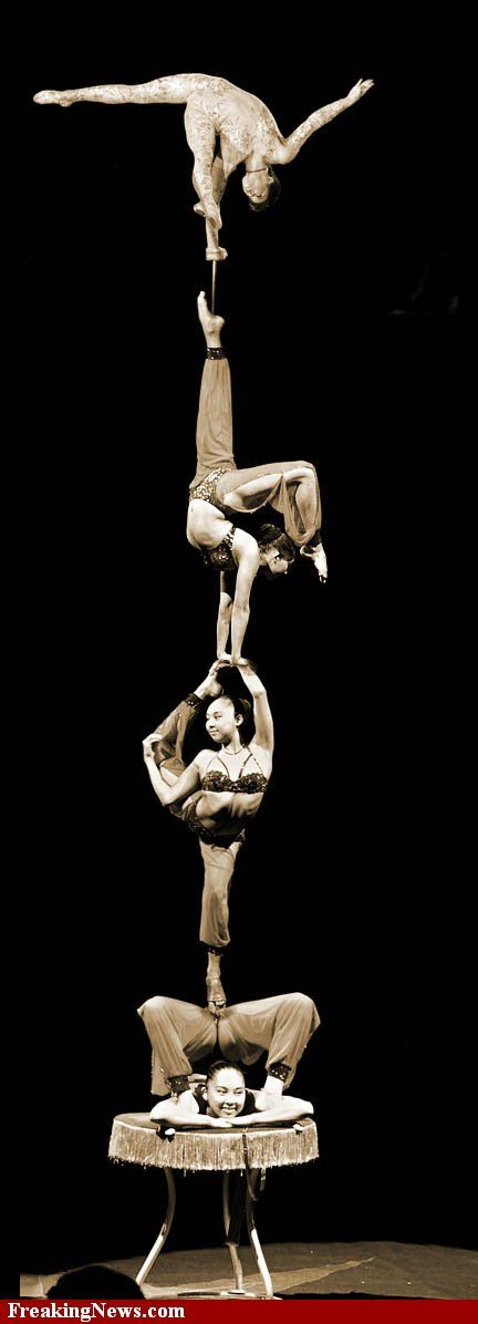 Acrobats...I'd hate to be on the bottom...ouch!
