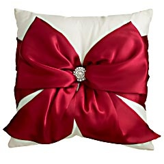 pretty pillow for Christmas...easy DIY... Satin ribbon from Hobby Lobby an old earring or brooch... simply wrap and Tie.