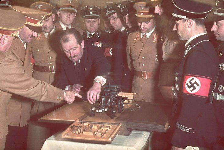 Ferdinand Porsche, the famed automobile designer, presents Adolf Hitler with the model of a tractor on the occasion of Hitler's 50th birthday in April 1939. Hitler's birthday was always an opportunity for grand celebrations, at least during the years preceding the war.