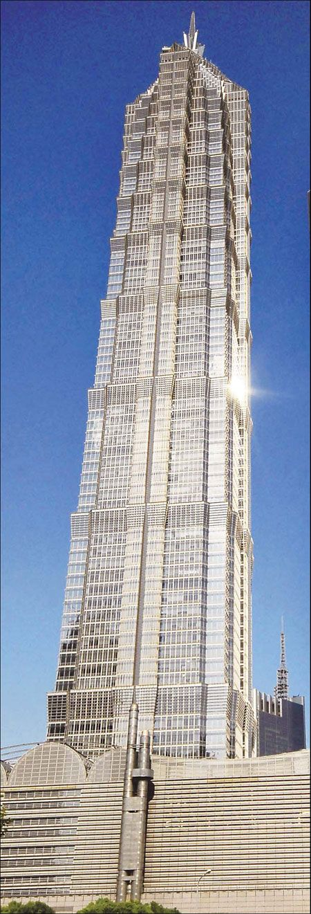 The Jinmao Tower's postmodern form has many Asian attributes built in including traditional Chinese architecture such as the tiered pagoda and the building's proportions that revolve around Chinese number 8.