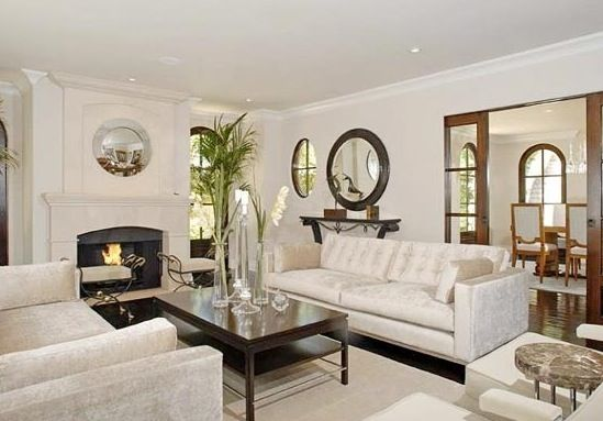 Kim Kardashian's Luxury Mansion Fireplace!  Kim Kardashian's living room uses clean lines and a touch of curves, with a combination of the two reflected in her fireplace and fireplace mantel. You can bring your room together in a similar way with our Montgomery modern stone fire place mantel that is the perfect combination of chic and cozy.