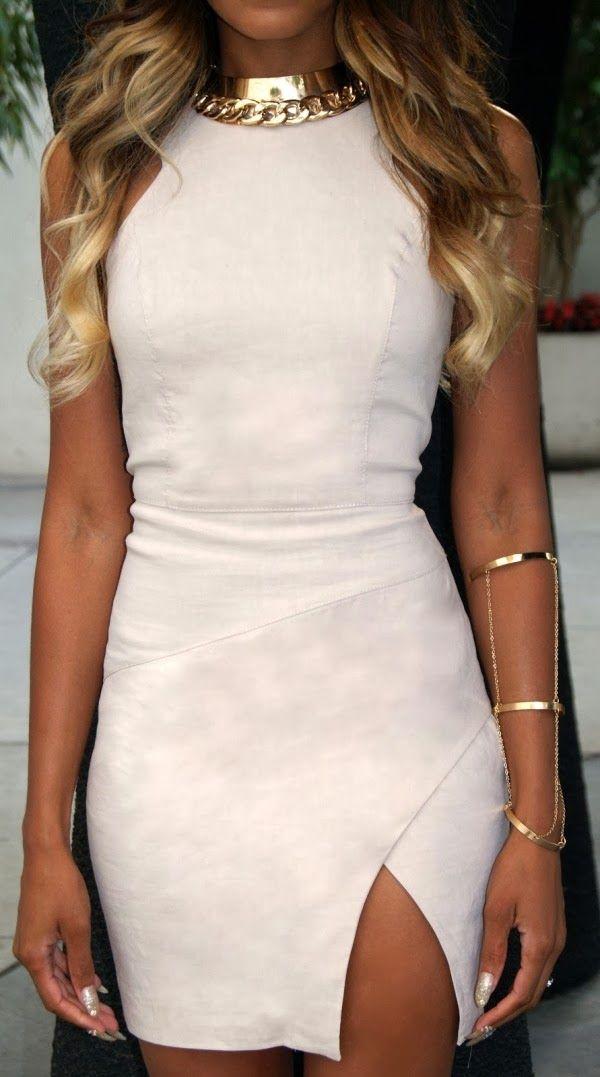 Attractive and glamorous sleeveless white mini dress