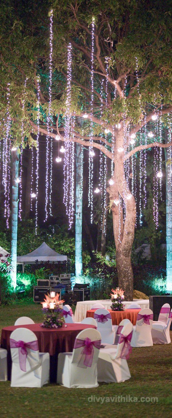 Sometimes minimalistic decor does wonders! Just like this one. All you need to do is have round table seating around a massive tree (at the venue/ or if there is one at your lawn), hang fairy lights and bulbs from the trees and get interesting floral centrepieces for the tables - and the ambience for a perfect evening party is made!