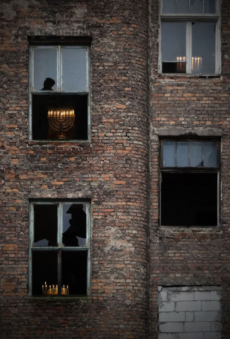 Where the Warsaw Ghetto once stood, Hanukkah candles light the night
