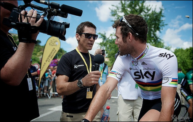 World Champion Mark Cavendish stopped in his tracks by none other than Robbie McEwen by kristof ramon, via Flickr. Tour de France 2012 - stage 14