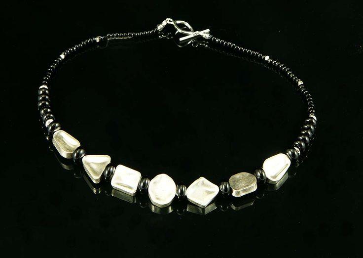 http://www.suzettejewellery.com/wp-content/uploads/2013/08/Desert-Oak-Seed-pod.-Sterling-silver.-Full-necklace.jpg