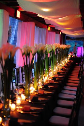 love the seating style with candles -c