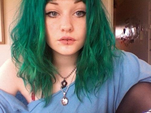 Green hair, lip ring