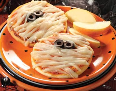 Easy Pizza Mummies- Cut English muffins in half and spread on pizza sauce. Using mozzarella string cheese, lay strips across to look like a mummy. Then add two slices of black olives for the eyes. Bake until cheese melts.