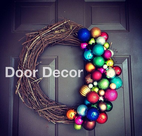 A blend of modern and classic this wreath will be a fun addition to your holiday decor. A grapevine wreath adorned with multi coloured bulbs.