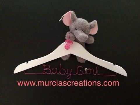 """""""Baby Girl""""  Coat Hanger. Isn't it cute? Lovely handmade white hanger with wording in magenta wire and a fluffy baby elephant. The perfect gift idea for baby showers and newborns. $23. Aud."""