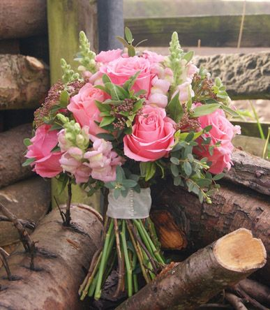 Pink hand-tied garden bouquet of roses, snapdragons and skimmia berries. Florissimo, Shropshire