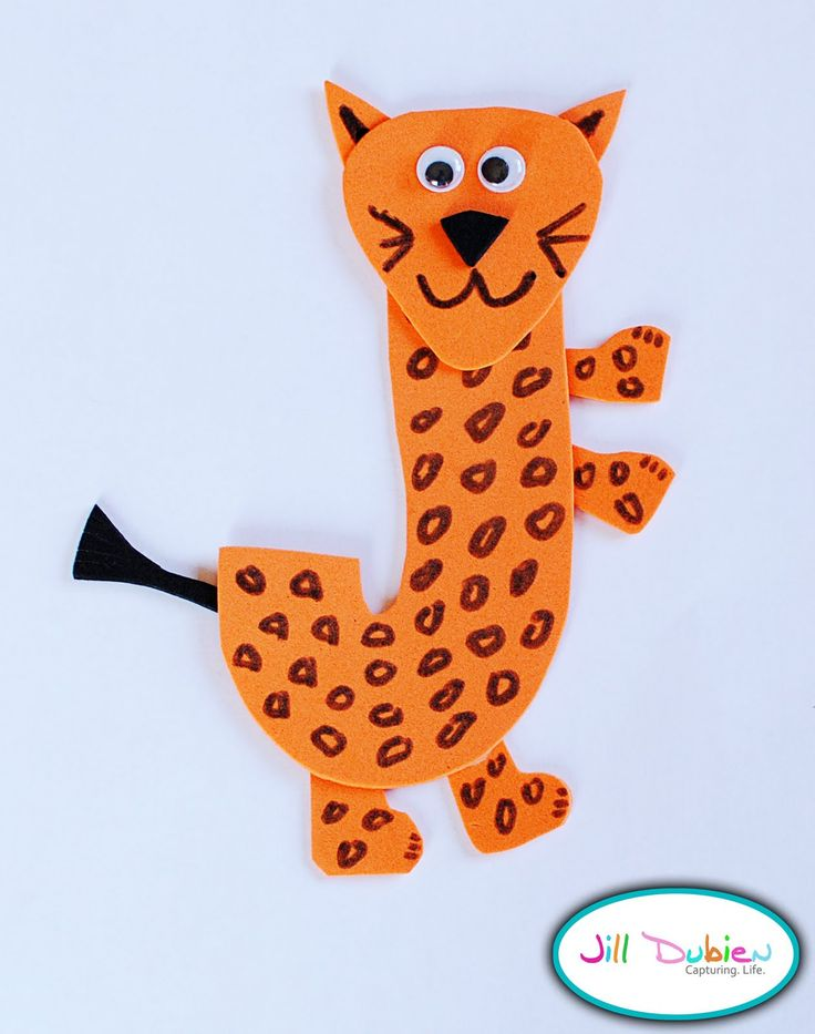 How to make the 'J' Jaguar: 1.Trace and cut an uppercase 'J' out of the orange foam sheet.  2.Using the excess orange foam, cut out small ears, four legs/feet and a face for your jaguar.3.Draw spots all over the letter J to give your jaguar some spots.4.Glue on the legs, ears and face. Add the eyes too!6.Draw claws on your jaguars feet as well as a mouth on his face, colour in the ears.7.Use the black foam sheet to cut out a tail and nose - glue on jaguar.