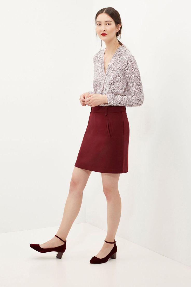 Minifalda línea A. Bolsillos falsos en el delantero. Cinturilla con trabillas y cierre con cremallera invisible en la parte trasera. | Faldas | Cortefiel