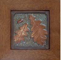 Framed Oak leaf & Acorn tile in green and copper glaze. Frame by Family Woodworks LLC