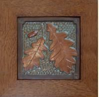Framed Oak leaf & Acorn tile in green and copper glaze. Frame by Family Woodworks LLC