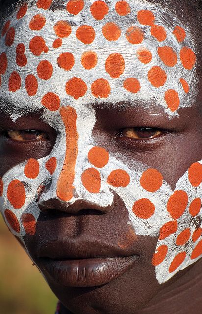Ethiopia, tribes, Kara people, close-up of the painted face of a young  man in Korcho village. The Karo people in South Omo call themselves 'Kara' which means 'fish'  in their language