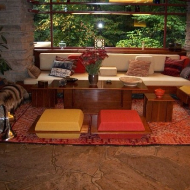 """The black walnut coffee table is surrounded by built-in sofas, high hassocks (12x26x21 3/4""""- covered in latex foam and wool, 1937) and zabutons (lower floor cushions, 25 1/2 x 29 3/4""""). Edgar Jr. referred to them as """"free floating seats"""" and """" it depends entirely on how laid-back you are, which ones you use."""" Zippertravel.com"""