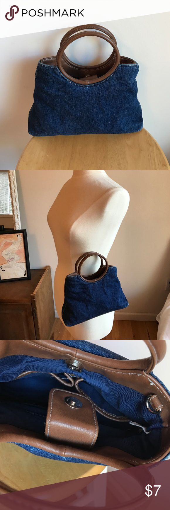 Small Denim Handbag This small denim handbag measures 10 x 6 x 2.5. It has two pockets and one zipper pocket inside. Magnetic closure and loops for attaching a longer strap. Faux leather details. no brand Bags Mini Bags