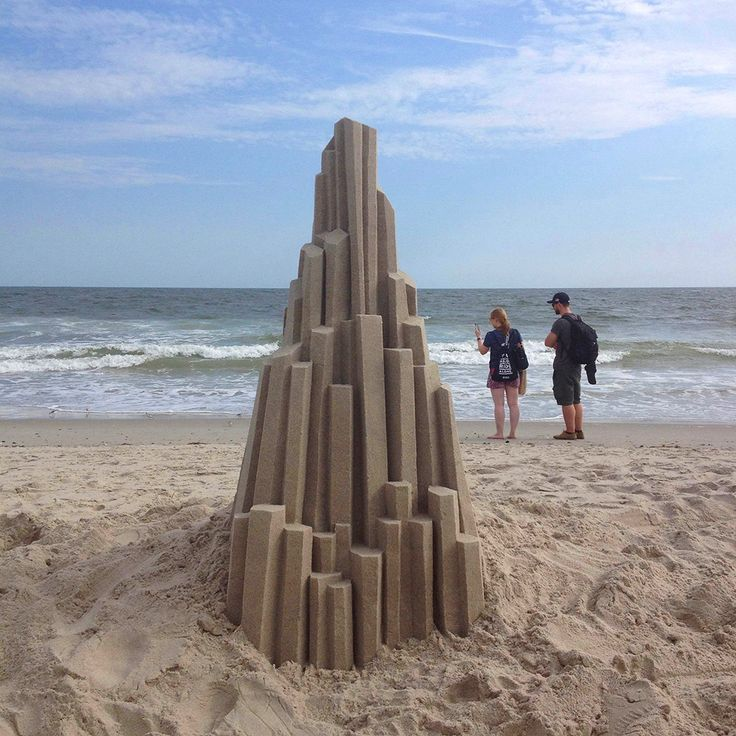 Artist Calvin Seibert spent part of the summer on Rockaway Beach in Queens where he made quick work of erecting several of his trademark geometric sandcastles that we've admired for years here on Colossal. Seibert is a professional sculptor who relishes the challenge of building these temporary sand
