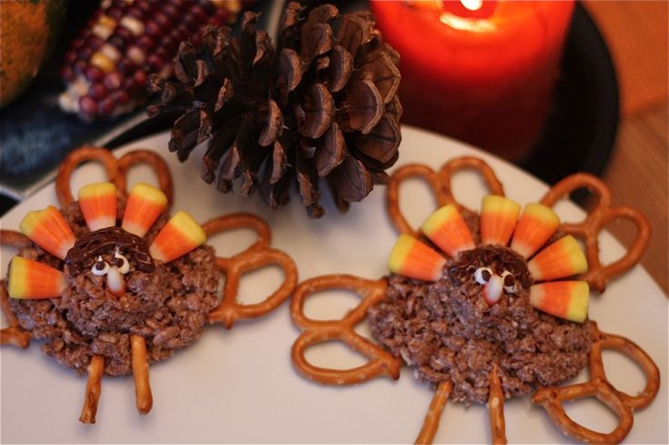 """Chocolate Rice Krispie Turkeys~ Chocolate Rice Krispies, rounded and straight pretzels, left over candy corn and Chocolate and vanilla candy melts for the turkey's """"hair"""" and eyes."""