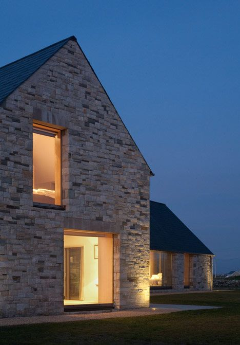 Contemporary Stone Architecture. Deep window reveals. Large areas of glazing out to countryside