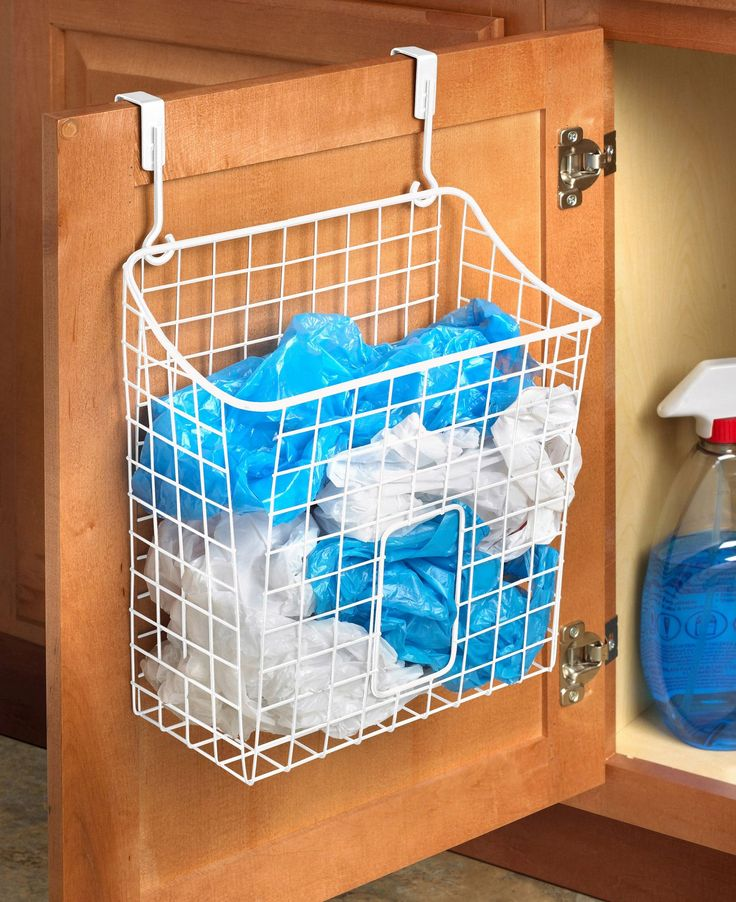 found it at wayfair over the cabinet grid trash bag holder - Trash Bag Holder