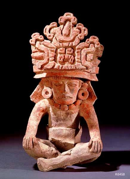Zapotec. clay. height 22.9 cm. Seated figure with maize plants in headdress.