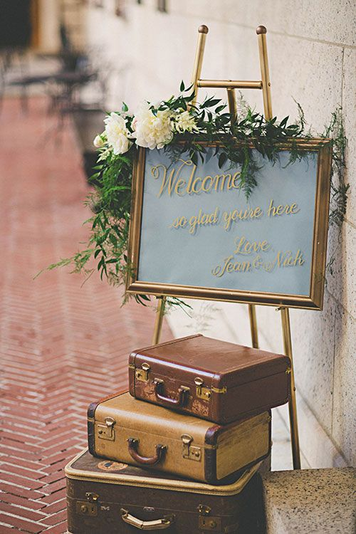 Intimate East-Meets-West Boston Wedding, Ceremony Sign with Floral Garland | Brides.com | Photo: Katch Studios