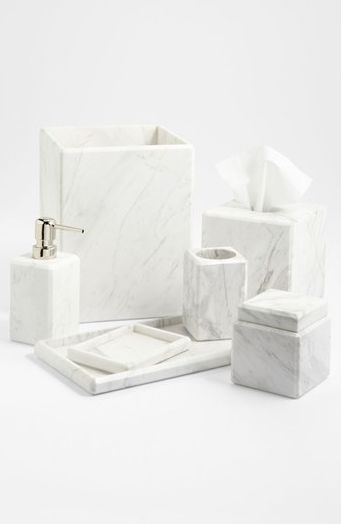 Or for a less costly approach to using marble products, look to these beautiful marble accessories for your bathroom by US brand, Waterworks.