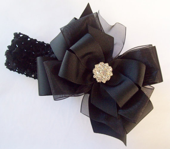 Little Black Hair Bow This bow is perfect for kids, Teens or women. This bow looks beautiful worn alone but includes a black headband for a different look or for a little girl.