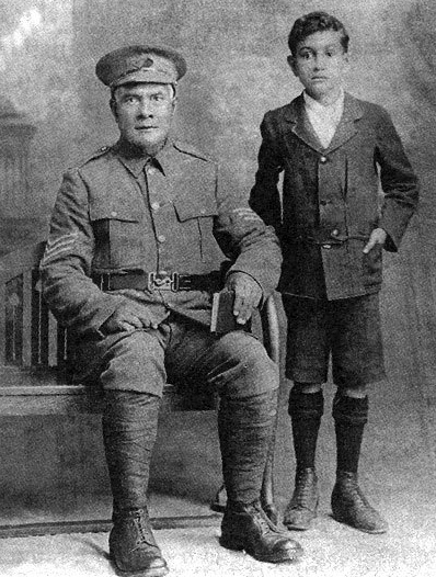 Sergeant-Major Uea of Niue with his son Makanetiaki, photographed after their arrival in New Zealand. Makanetiaki became a boarder at St Stephen's College while Uea served as a chaplain in the Niue contingent.