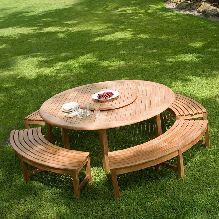 Combining the popular Buckingham 6 ft Teak Round Table  with the Buckingham Backless Benches  creates a perfect level of comfort for outdoor dining and picnicking. The table accepts an optional umbrella to keep you in the shade during those long summer days, while an optional Lazy Susan provides all around access to the barbecue, corn on the cob, and all the picnic essentials. The Buckingham Backless Bench Set features: 1 Six foot Buckingham Round Table, 4 Buckingham Backless Benches.