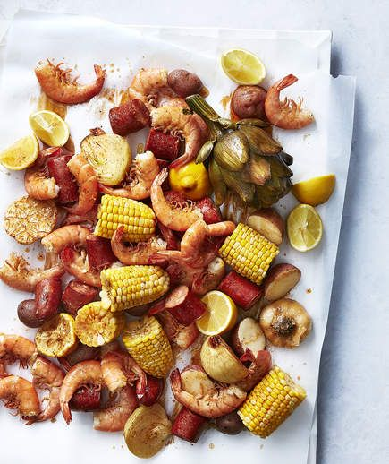 Easy Stovetop Shrimp Boil | A shrimp boil sounds like a big ordeal, but this recipe is actually a one-pot dinner. Just throw the onions, lemon, garlic, potatoes, sausage, artichoke, shrimp, and corn into a large stockpot and bring to boil with some dry shrimp-and-crab boil seasoning. You can find the seasoning in the spice aisle near the old bay seasoning; we love the brand Slap Ya Mama Cajun Seafood Boil because it has good ingredients (read: no MSG). After just about 20 minutes of cook…