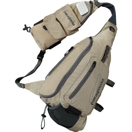 The Patagonia Fly Fishing Vest Front Sling takes the best of a fishing vest and blends it with prime features of sling packs so you don't have to choose between a vest or sling. A row of vertical pockets gives you the best of the vest, while a large storage pocket sings the praises of the sling. Light and breathable, the body of this sling-vest is made from 210D polyester 3-D spacer mesh. The shoulder harness and back panel are crafted from pure polyester. Small pockets hold small gear. The…