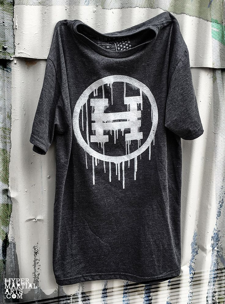 Join the Revolution! This Hyper Circle H has been ripped straight from the wall of the world and onto the chest of the shirt. White print on Charcoal Heather shirt. 52% Cotton / 48% Polyester Super Soft. Made in USA