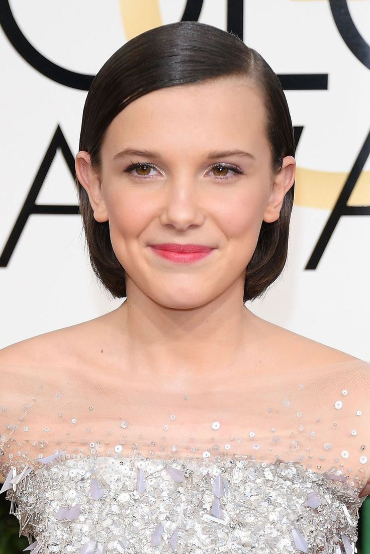 Millie Bobby BrownThe Stranger Things star may only be 12-years-old, but she's totally schooling us on how to rock post-buzz-cut regrowth.  #refinery29 http://www.refinery29.com/2017/01/135131/golden-globes-2017-best-hair-makeup-photos#slide-6