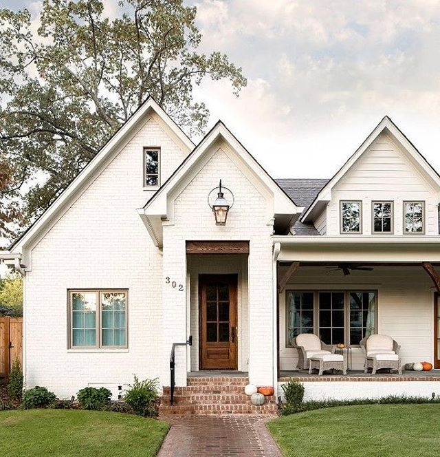 White brick exterior with front porch