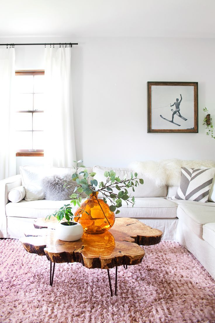 Feminine living room with a white sectional, a pink rug, and a wood coffee table  // @shnordic