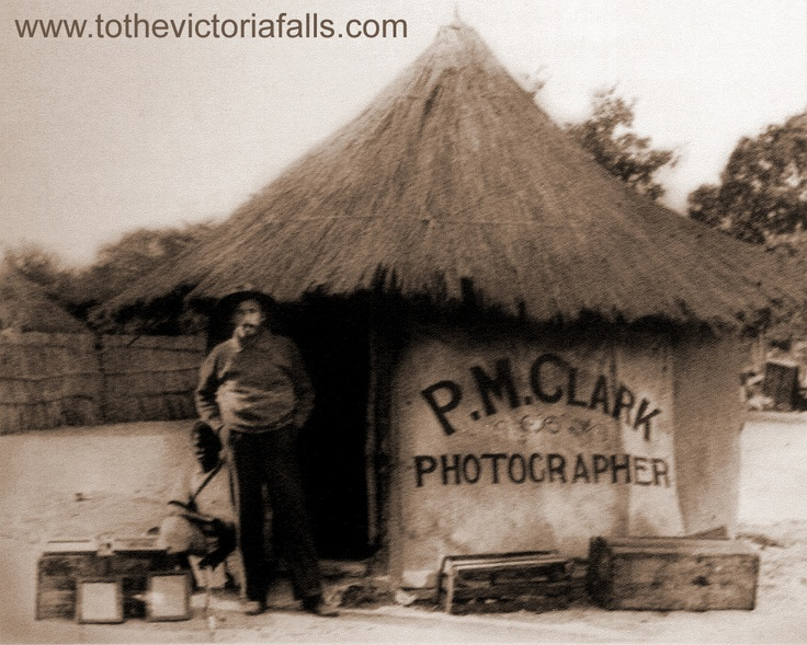 Percy M Clark outside his photographers hut. Clark was the first resident of the new settlement of Victoria Falls.