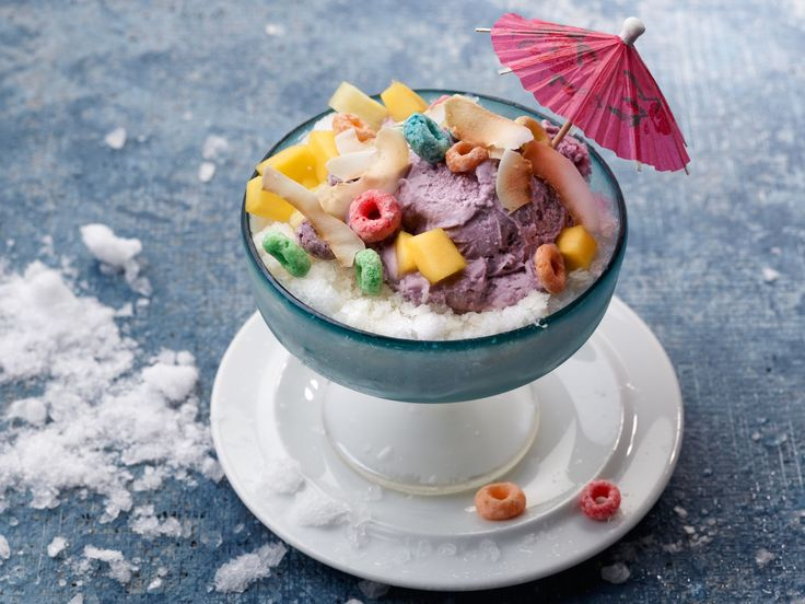 """Snow Halo Halo : A Southeast Asian dessert whose name translates into """"mix mix,"""" so it's """"everything but the kitchen sink."""" Dress up snow at home and make your own version of halo halo. Pack a parfait glass about 3/4 of the way full with fresh snow. Drizzle with evaporated milk to taste. Top with a scoop of vanilla or black raspberry ice cream (to mimic the traditional purple yam kind). Decorate with chopped fresh fruit, like pineapple or mango, large tapioca pearls, toas..."""