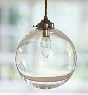 A full circular glass pendant light made by JIm Lawrence