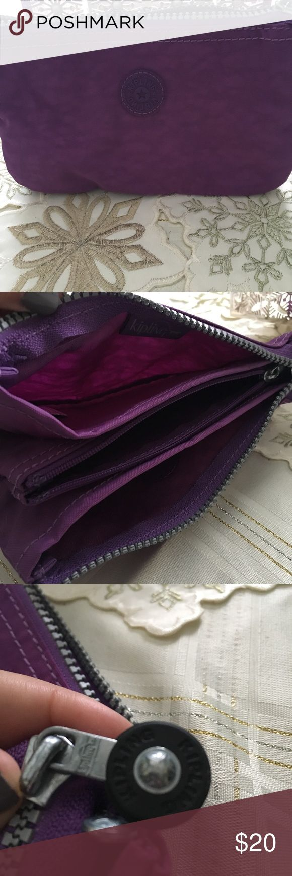 Kipling pouch Kipling pouch, in excellent condition except missing monkey. Authentic, color is violet purple. One main zipper pocket, one inside zipper pocket, two open pockets inside. Very versatile pouch, nylon Kipling Bags