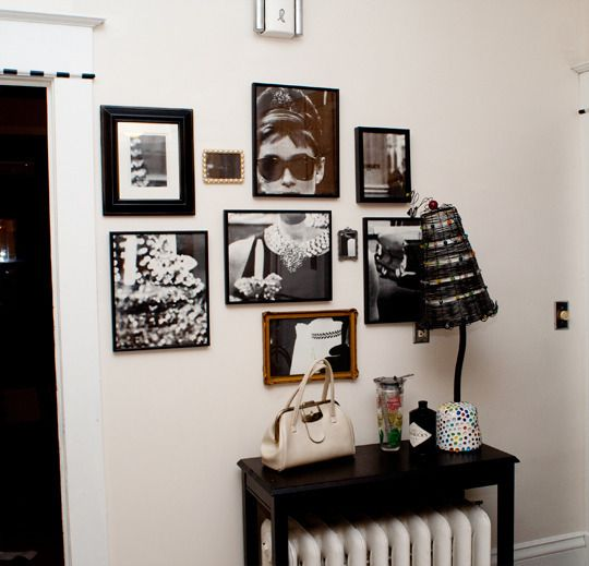 """My sister found a poster of a photograph of Audrey Hepburn in Breakfast at Tiffany's in a trash heap in her neighborhood. The poster had torn edges and was wrinkled so she used several old picture frames to salvage the usable parts of the poster and spruce up her kitchen."" This is an easy way to breathe life into old frames and repurpose larger posters."